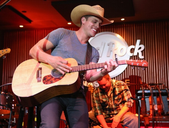NASHVILLE, TN - JUNE 04:  Dustin Lynch performs during the 2013 Country Weekly Kick-Off party at the Hard Rock Cafe Nashville on June 4, 2013 in Nashville, Tennessee.  (Photo by Andrew Goodman/Getty Images)